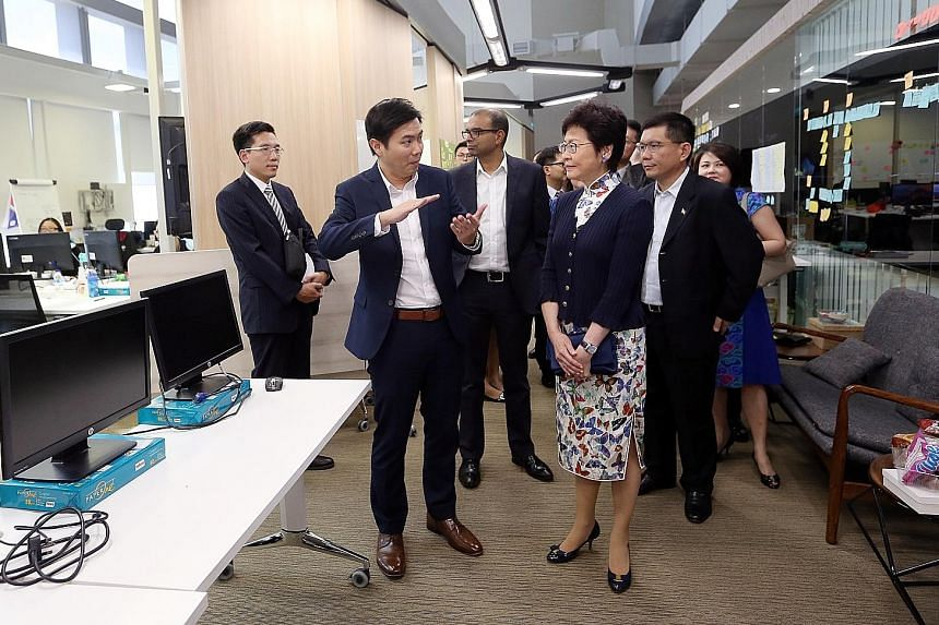 Hong Kong Chief Executive Carrie Lam visiting GovTech Hive at the Sandcrawler in Fusionopolis yesterday, accompanied by (from second left) Mr Mark Lim, director of product design and development at GovTech; Dr Janil Puthucheary, Senior Minister of St