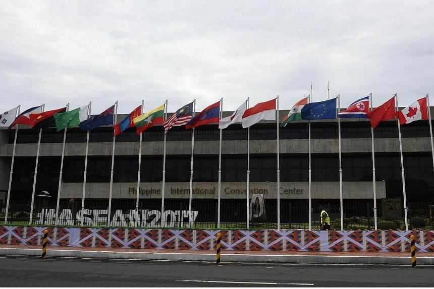 A policeman walks past various national flags at the venue of the Association of Southeast Asian Nations (Asean) Regional Forum (ARF) meeting in Manila, on Aug 3, 2017.