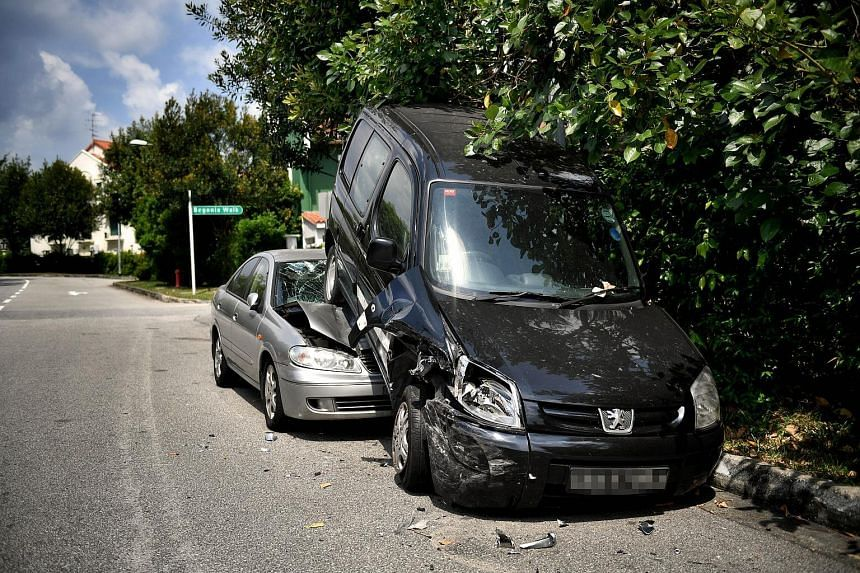 The impact from the initial collision, pushed the black van backwards onto the silver car.