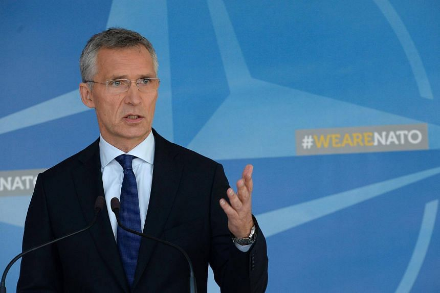 Nato Secretary General Jens Stoltenberg talks to the media at Nato headquarters in Brussels.