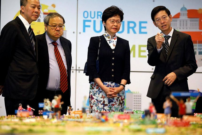 Hong Kong chief executive Carrie Lam looking at a model of Singapore at the Urban Redevelopment Authority (URA) office in Singapore, on Aug 3, 2017.