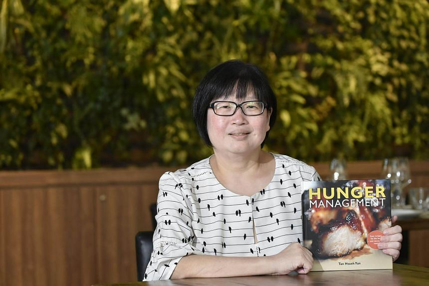 The Straits Times Life editor Tan Hsueh Yun with her new cookbook Hunger Management.