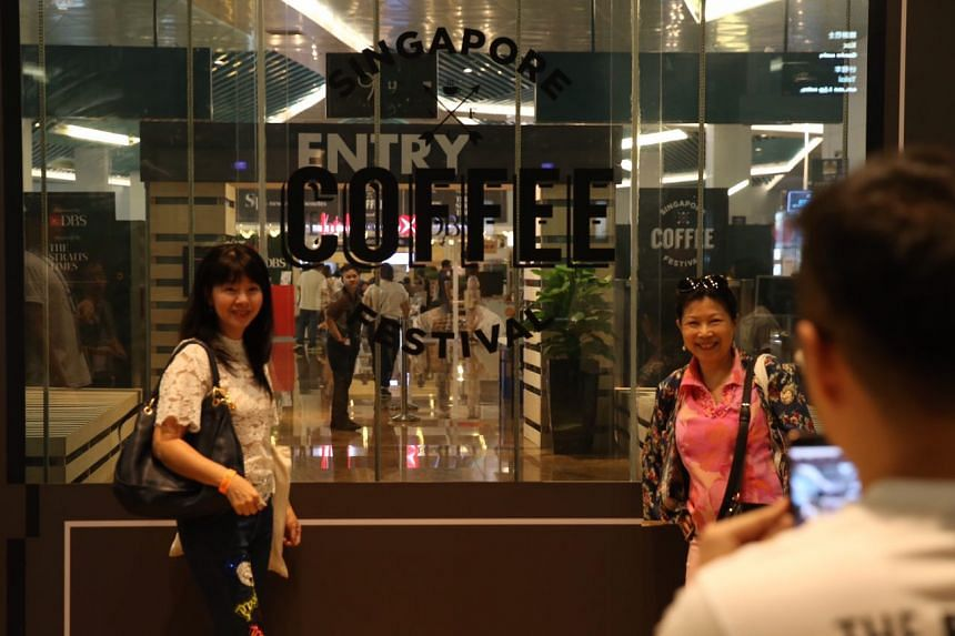 Visitors posing for a photo during the first day of the Singapore Coffee Festival 2017.