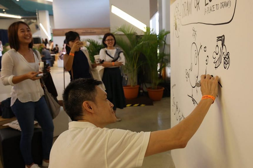 ST artist Lee Chee Chew leaving his mark on the graffiti wall at the Singapore Coffee Festival 2017.