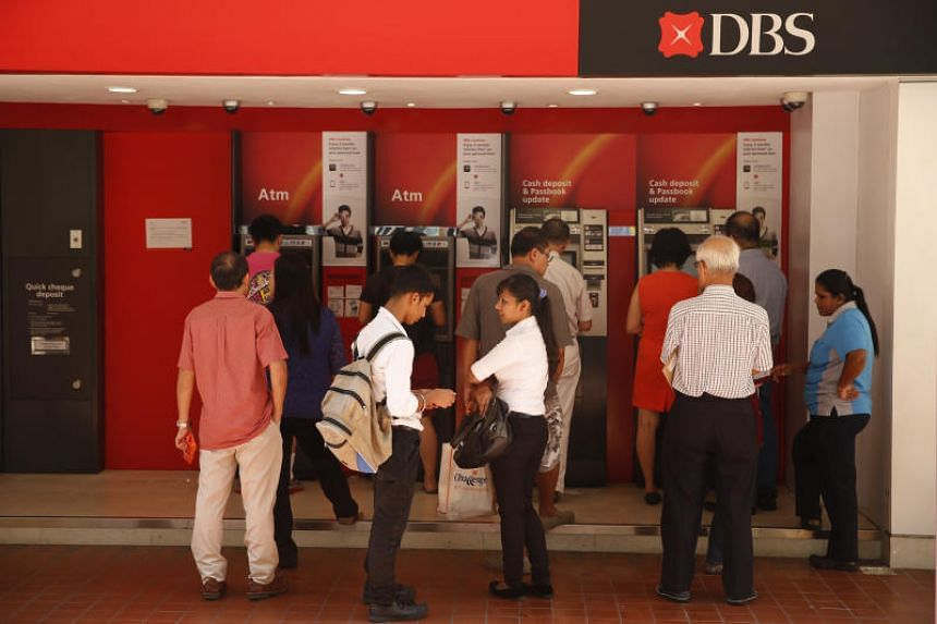 A file picture of people queuing at the DBS ATMs in Chinatown. PHOTO: SPH