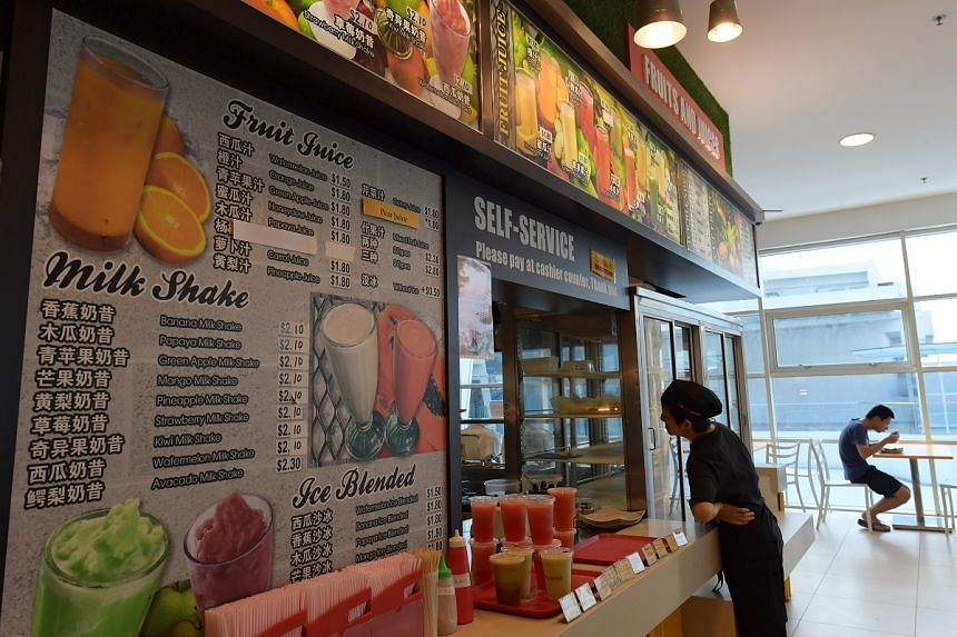 A drinks stall with a bilingual menu at a foodcourt in Nanyang Technological University.