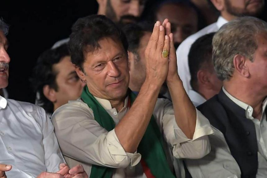 Pakistani opposition leader and head of the Pakistan Tehreek-i-Insaf (PTI) party Imran Khan speaks to supporters during a rally in Islamabad on July 30, 2017.