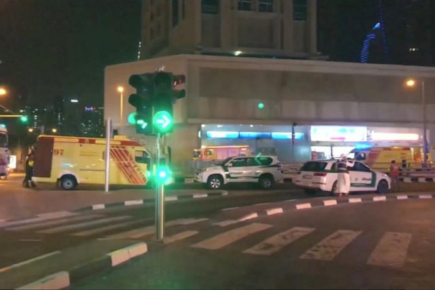 A still image taken from video shows emergency vehicles near the scene of the fire that broke out in Dubai's Torch Tower.