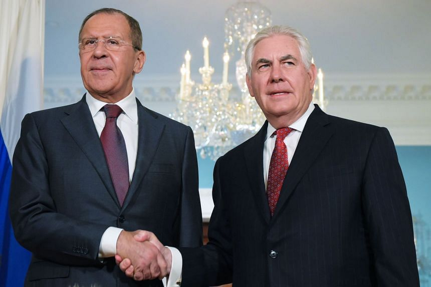 Lavrov (left) and Tillerson  shaking hands in Washington in May 2017.