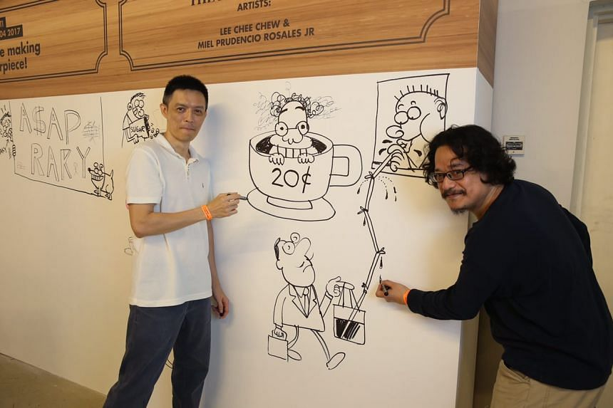 ST artists Lee Chee Chew and Miel at the graffiti wall at the Singapore Coffee Festival 2017.