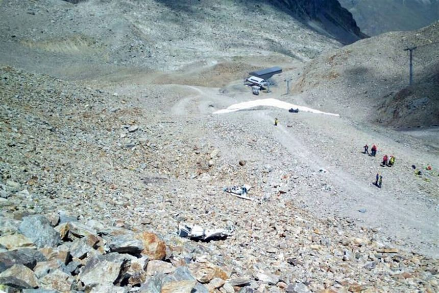 A handout photo shows a general view over the crash site with the debris of a small aircraft.