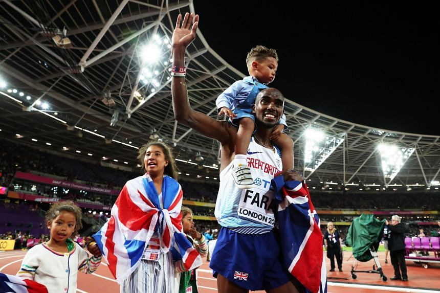 Mo Farah of Great Britain celebrates with his family after winning the men's 10000m final.