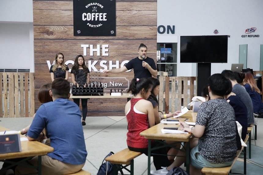 Singapore Coffee Festival visitors attending the Craft Your Own Fragrance session at The Workshop, on Aug 5, 2017.