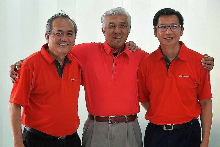 Featured in ST Engineering's book are (from left) ST Electronics' Mr Yong Thiam Chong, ST Engineering's Mr Patrick Choy and ST Marine's director of weapons and electronics, and system integration, Mr Steve Wong.