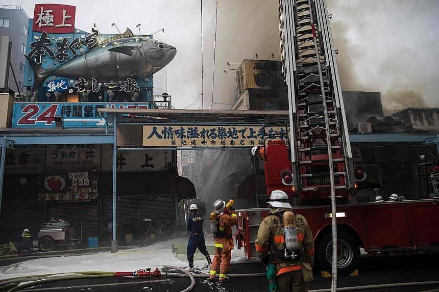 Firefighters trying to extinguish the fire at Tokyo's famous Tsukiji fish market on Thursday. A Tokyo Fire Department spokesman said the cause is still under investigation.