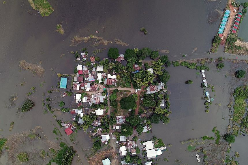 A flooded area in Sakon Nakhon province, north-east Thailand, yesterday. Ten of the 77 provinces have been inundated in the middle of the annual rainy season, causing damage estimated at US$300 million (S$407 million).