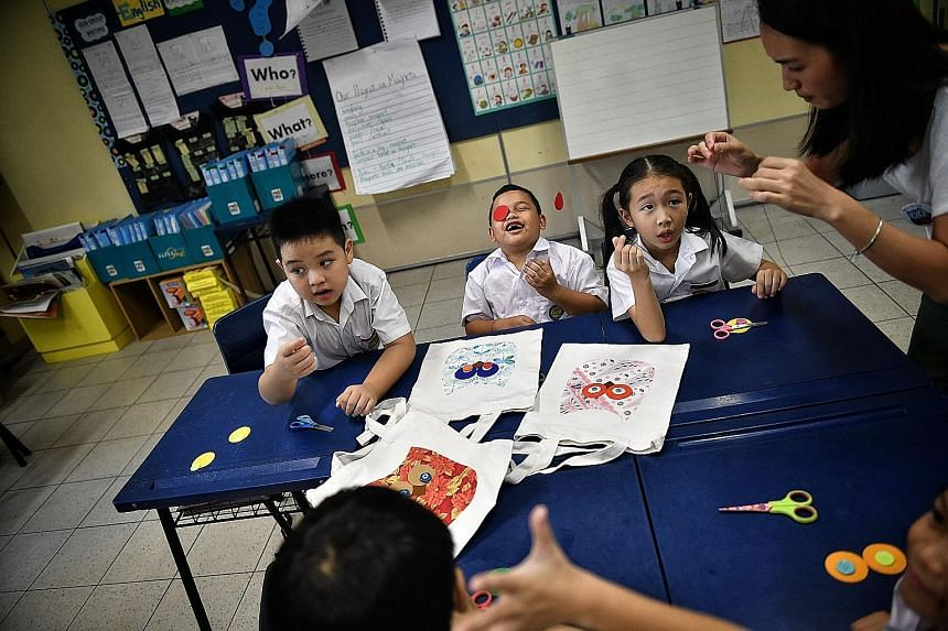 Armed with scissors, sewing thread and a needle, eight-year-old Wielky Almatis (centre) and his schoolmates work on special tote bags. But this is no typical arts and crafts class at Yu Neng Primary School. It is part of an effort by ChildAid, an ann