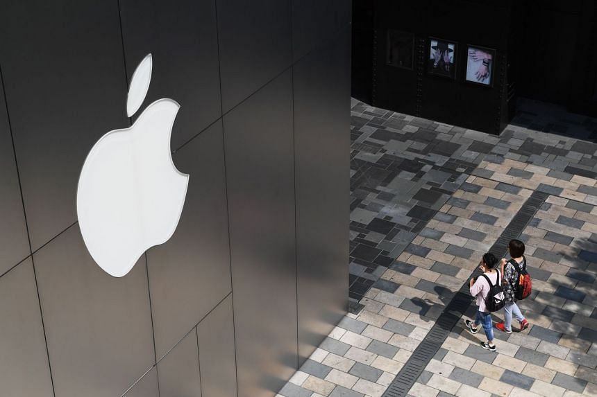 People walk past an Apple store in Beijing on Aug 3, 2017.