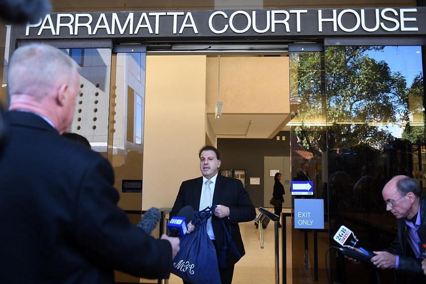 Michael Coroneos, the lawyer for two terror suspects, leaves the Parramatta Local Court following a brief appearance in Parramatta, Sydney, New South Wales, Australia, on Aug 4, 2017.