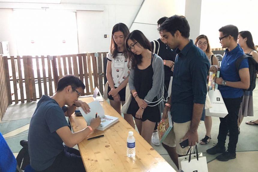 Sonny Liew signs copies of his graphic novel at the Singapore Coffee Festival on Aug 5, 2017.