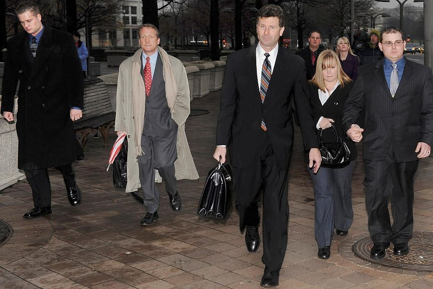 Blackwater Worldwide security guards Evan Liberty (left) and Dustin Heard (right) leave the federal courthouse with their legal team and supporters, on Jan 6, 2009.