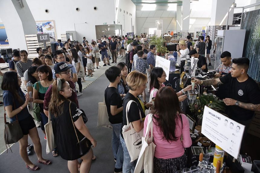 Visitors queueing in front of The Coffee Academics for its coffee in a cone at the Singapore Coffee Festival at Marina Bay Cruise Centre, on Aug 5, 2017.