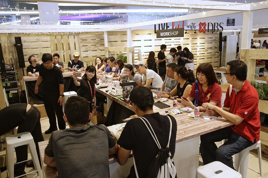 Visitors at the coffee brewing workshop with Bettr Barista at the Live Kind With DBS booth, on Aug 5, 2017.
