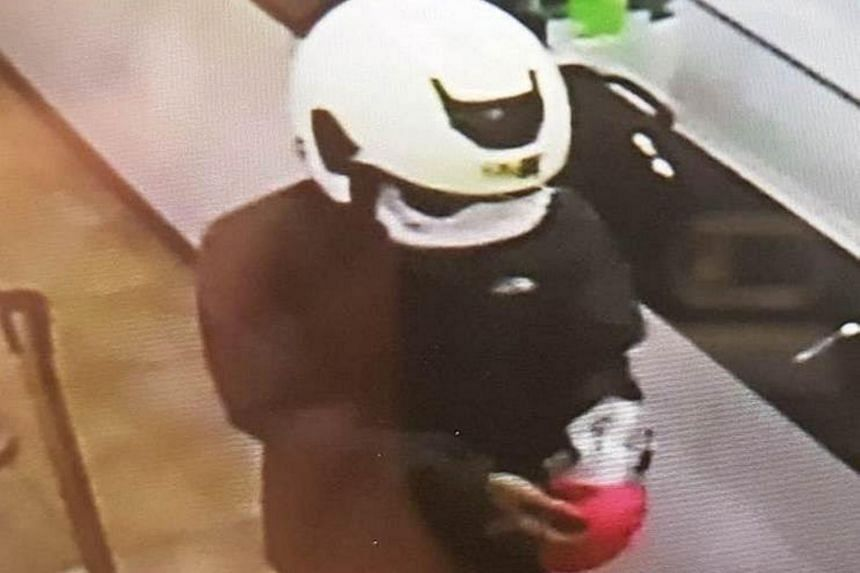 The suspect involved in the armed robbery at Western Union branch in Ubi.