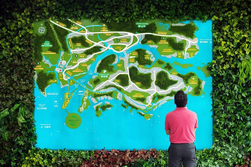A man looks at a map of Malaysia and Singapore inside a showroom at the Country Garden Holdings Co. Forest City Industrialised Building System (IBS) facility in the Iskandar Malaysia zone of Johor Bahru, on Aug 4, 2017.