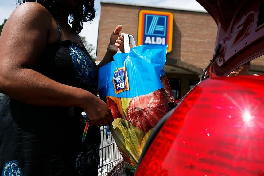 A woman putting her groceries into the trunk of her car after she shopped at an Aldi store in Alexandria, Virginia on Aug 24, 2009.