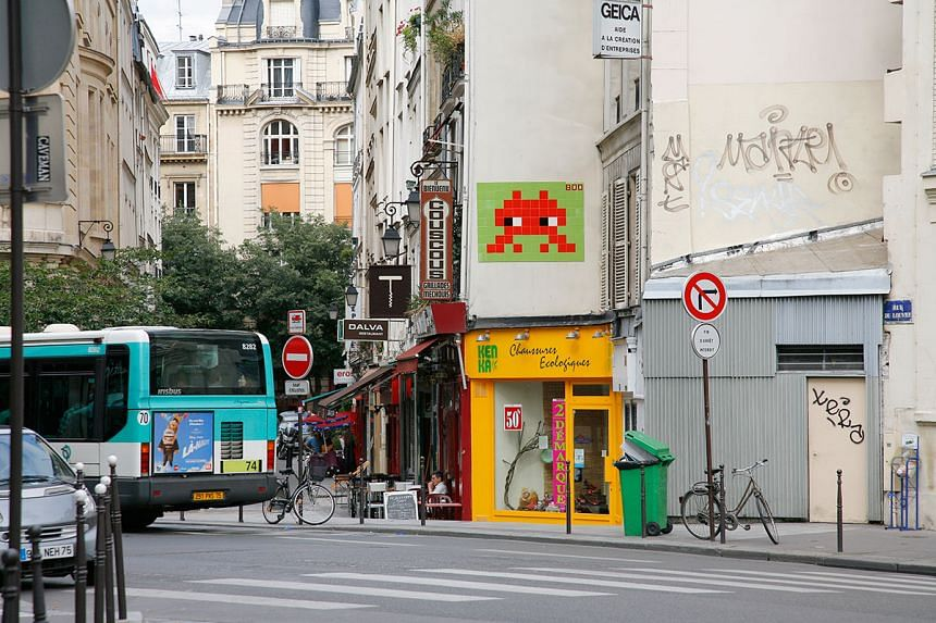 One of the artist's many works on a Paris wall.