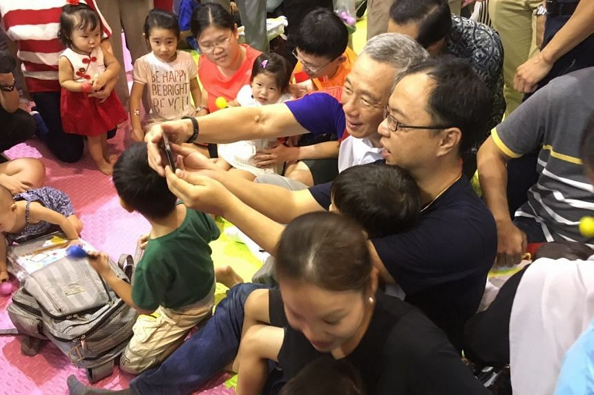 A baby carnival attended by PM Lee at the Yio Chu Kang Community Club on Saturday (Aug 5).