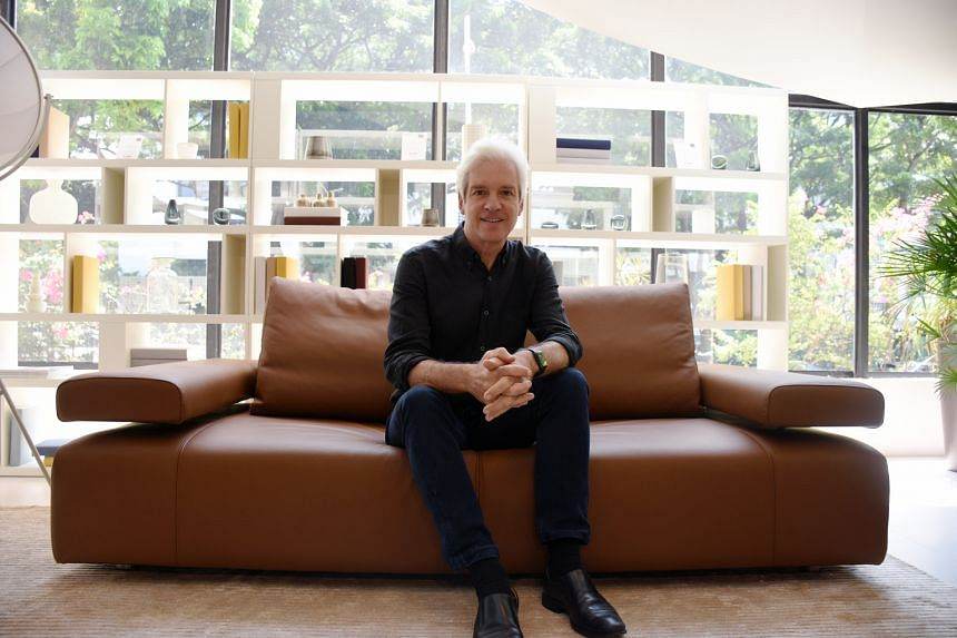 Mr David King, sitting on the Strata Sofa, started King Living with his mother in 1977.