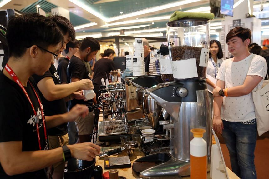 Baristas brewing up a storm as they prepare drinks for the many visitors at the Marina Bay Cruise Centre yesterday. There will be a host of events for visitors today, including a book launch and free yoga session.