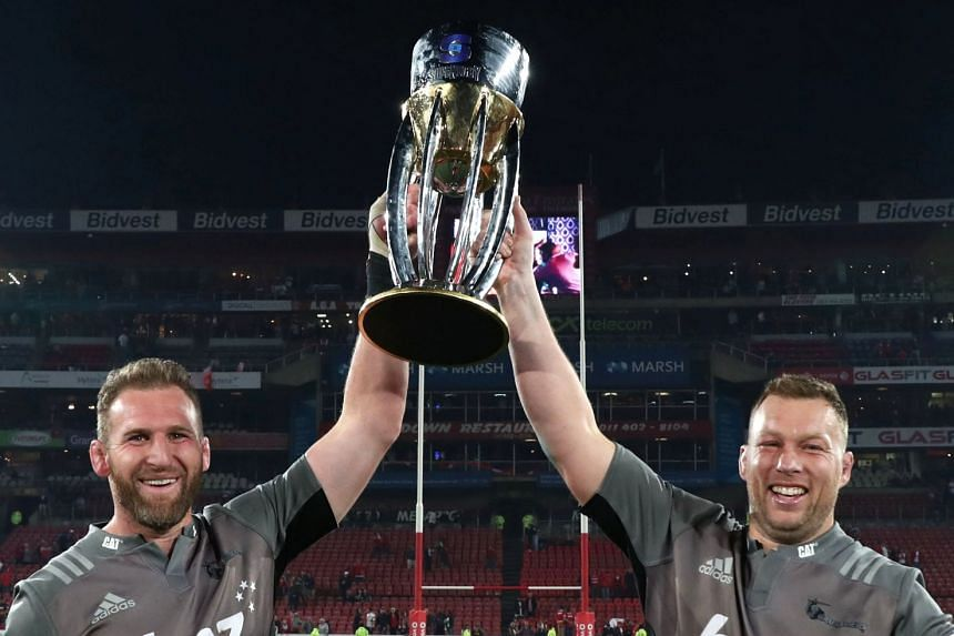 Kieran Read (left) and Wyatt Crockett of the Crusaders celebrate with the trophy.