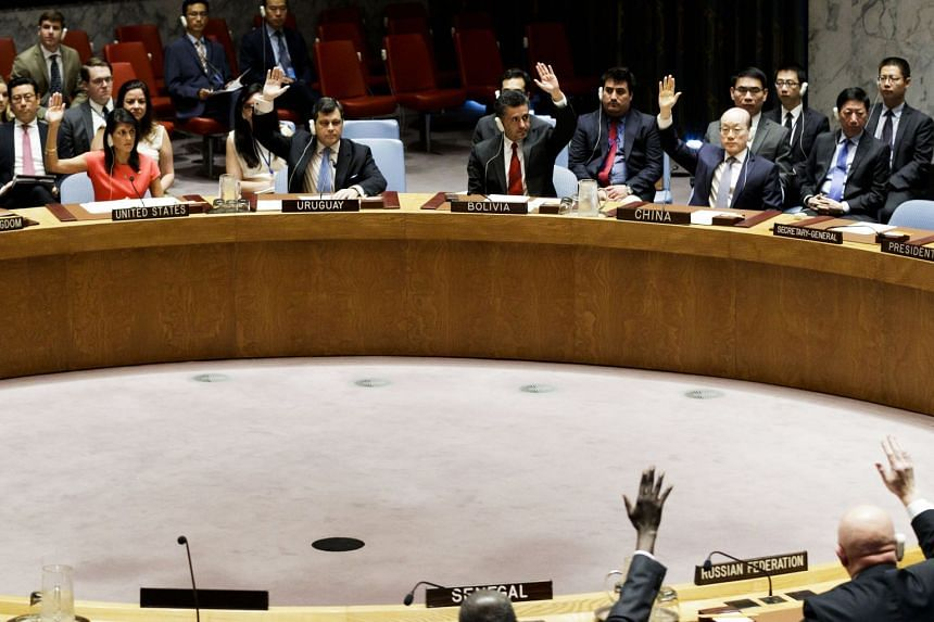 Security Council members, including the US, China and Russia, vote on a resolution to implement new sanctions against North Korea.
