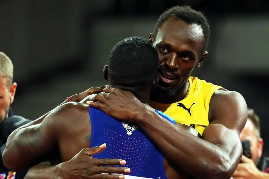 Justin Gatlin (left) of the US is congratulated by Jamaica's Usain Bolt.