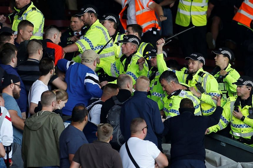 Hanover fans clash with police in the stands.