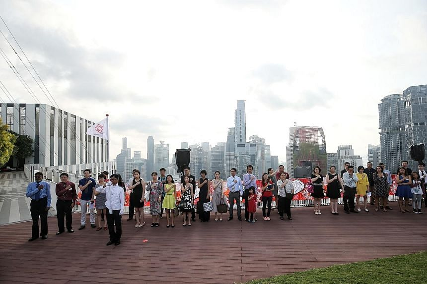 The new Singapore citizens sang the National Anthem and recited the Pledge at the citizenship ceremony organised by Tanjong Pagar GRC on the 50th floor of The Pinnacle@Duxton.