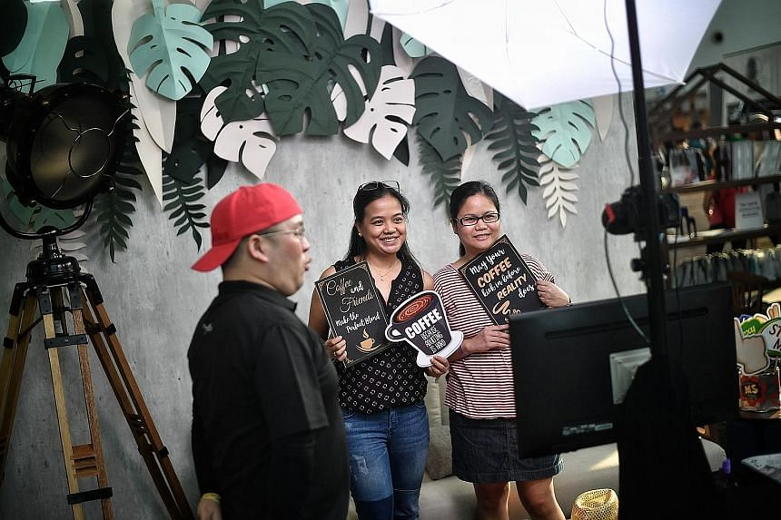 Right: A photo booth helped visitors take home their happy memories of the festival. Engineer Teguh Budiman, 24, who was at the Marina Bay Cruise Centre Singapore yesterday, said this year's festival was a huge improvement to last year's, and called