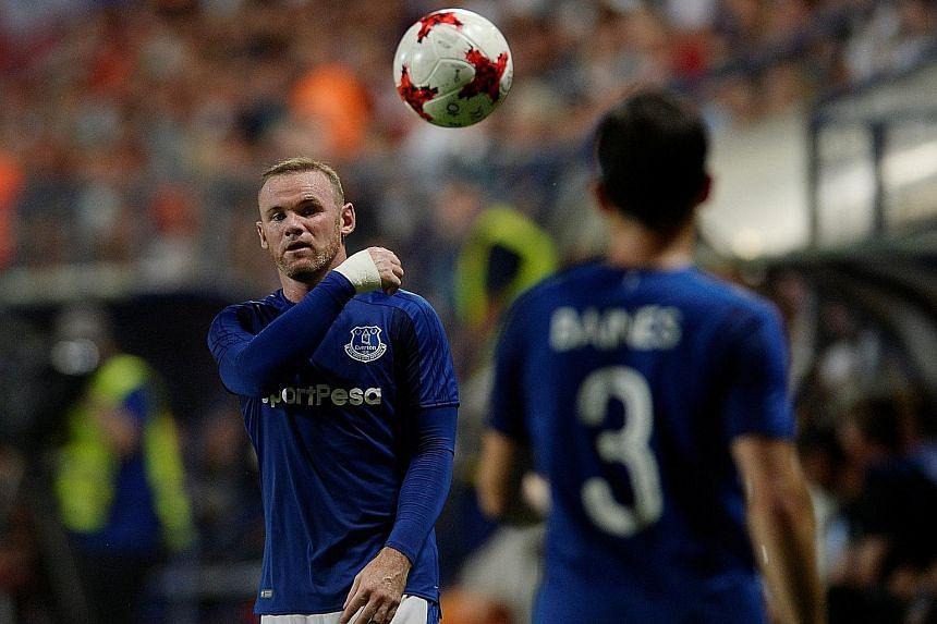 Wayne Rooney (far left, with Leighton Baines) during Thursday's return leg of the Europa League third qualifying round in Slovakia. The Toffees beat Ruzomberok 1-0 in both legs.