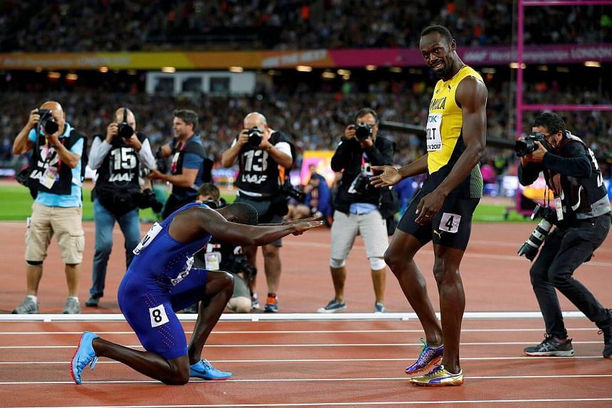 Usain Bolt of Jamaica with Justin Gatlin of the US after the final.