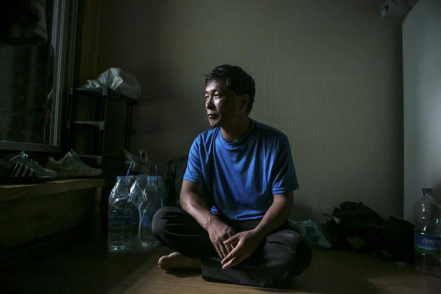 Kwon Chol Nam, a North Korean defector, in his half-basement studio home in Seoul on Aug 2, 2017.