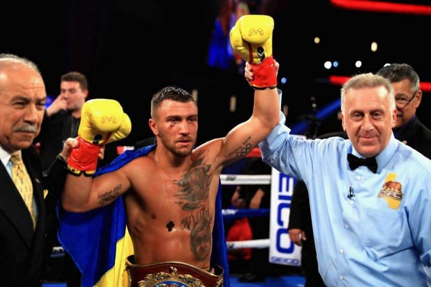 Vasyl Lomachenko celebrating after defeating Miguel Marriaga in their Junior Lightweight title bout in Los Angeles on Aug 5, 2017.
