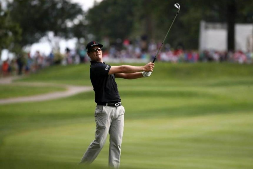 Zach Johnson plays a shot on the 18th hole during the third round of the World Golf Championships - Bridgestone Invitational at Firestone Country Club South Course on August 5, 2017.
