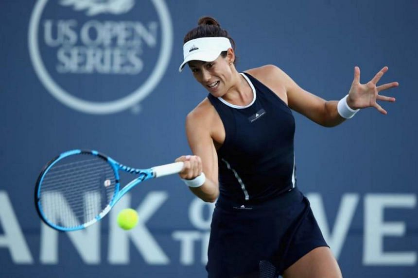 Garbine Muguruza of Spain returns a shot to Madison Keys of the United States during their semifinal match on Day 6 of the Bank of the West Classic at Stanford University Taube Family Tennis Stadium on August 5, 2017.