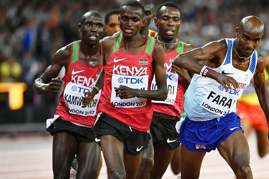 Mo Farah stumbling in the final leg of his 10,000m race. Later, he sported a bandage on his left leg, but insisted he would be fit to defend his 5,000m crown this week.