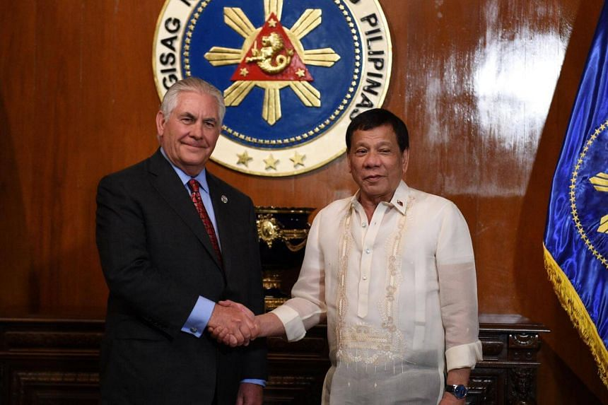 Philippine President Rodrigo Duterte shakes hands with US Secretary of State Rex Tillerson prior to their meeting at Malacanang Palace on Aug 7, 2017.