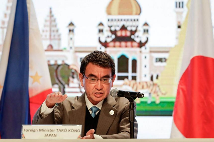 Japanese Foreign Minister Taro Kono gestures during a press conference in Manila, on Aug 7, 2017.