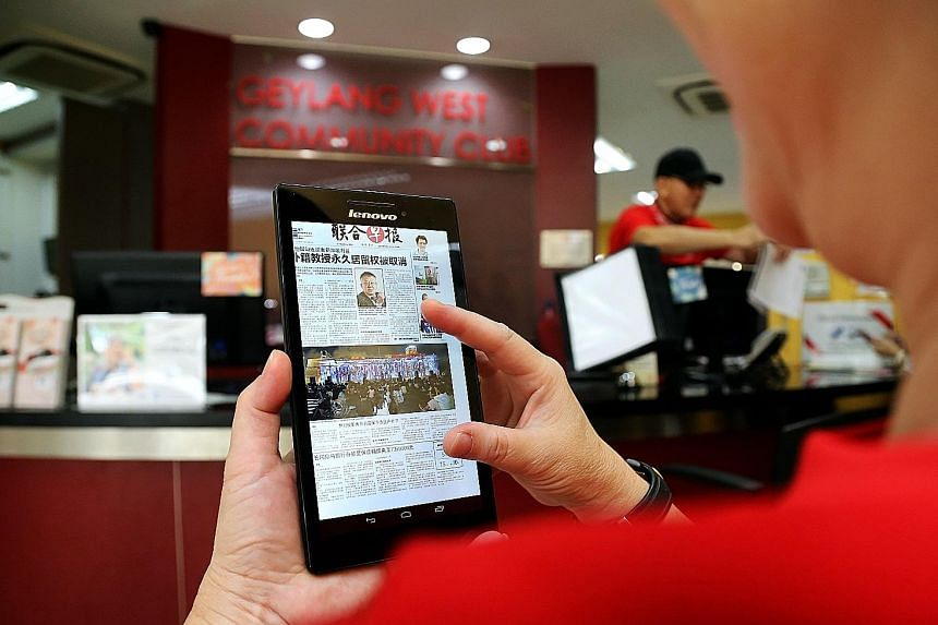 Residents visiting Geylang West Community Club can access digital newspapers like ST via six tablets.